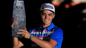 PONTE VEDRA BEACH, FL - MAY 10: Rickie Fowler celebrates with the winner's trophy after the final round of THE PLAYERS Championship at the TPC Sawgrass Stadium course on May 10, 2015 in Ponte Vedra Beach, Florida. (Photo by Sam Greenwood/Getty Images)