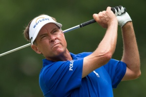 Davis Love III tees off on the third hole during the final round of the Wyndham Championship golf tournament at Sedgefield Country Club in Greensboro, N.C., Sunday, Aug. 23, 2015. (AP Photo/Rob Brown)