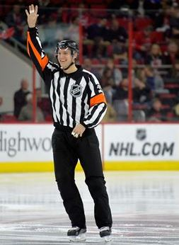 Garret Rank, 27, referees his second NHL game over the Carolina Hurricanes versus the New Jersey Devils on March 28, 2015 in Raleigh, North Carolina. (Photo by Sara D. Davis for The Waterloo Region Record)